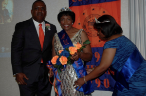 SAVANNAH, Ga. — SSUNAA National President Clyde Newton (l) and 2014 SSUNAA National Queen Pamela Yancy-Holmes (r) present the official sash to the 2015 National Queen, . photo by Absolon Kent
